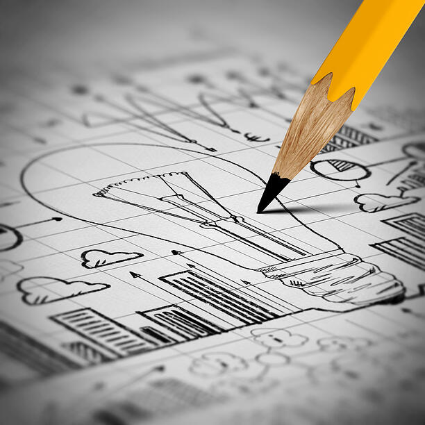 Close up image of pencil sketch with business ideas and strategy