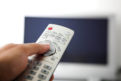 tv remote control with big flatscreen at the back